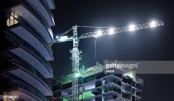 skyscraper construction site at night