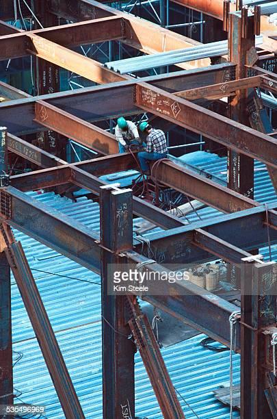 Skyscraper construction with steel workers