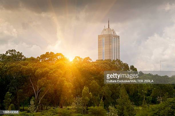 skyscraper overlooking rural landscape - nairobi stock pictures, royalty-free photos & images