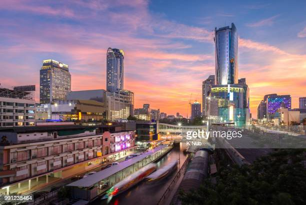 Skyscraper, skyline and boat transportation in canal at Pratunam, downtown of Bangkok Thailand in sunset time
