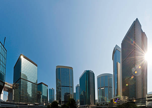 Skyscraper sunburst downtown business district glass citadels Hong Kong China