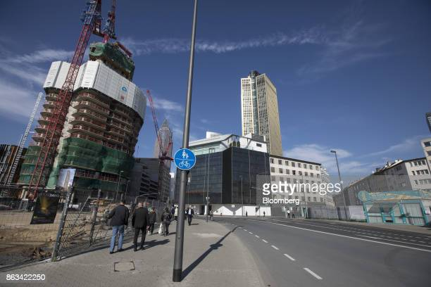 Skyscraper Tower 185, right, stands as construction work continues on high-rise residential property Grand Tower in Frankfurt, Germany, on Wednesday,...