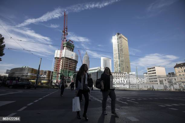 Skyscraper Tower 185, right, stands as construction work continues on high-rise residential property Grand Tower, left, in Frankfurt, Germany, on...