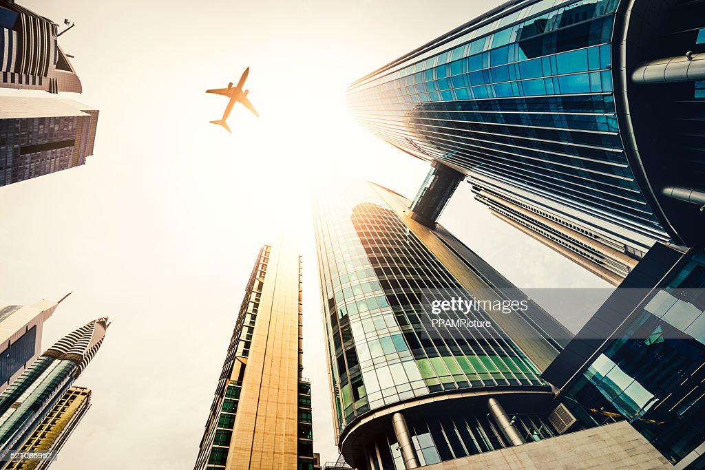 Skyscraper with a airplane silhouette : Stock Photo