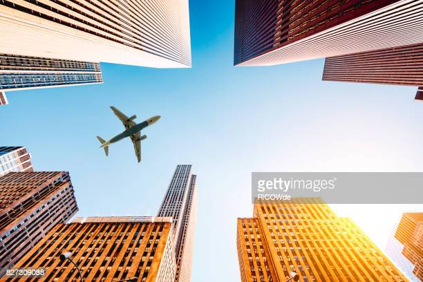 skyscraper with a airplane silhouette - aeroplane stock photos and pictures