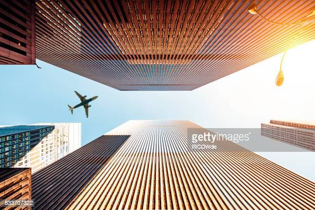 skyscraper with a airplane silhouette - business travel stock pictures, royalty-free photos & images