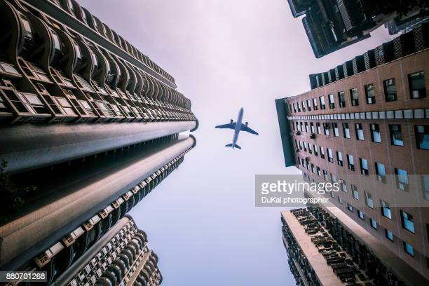 skyscraper with a airplane silhouette - chongqing stock photos and pictures