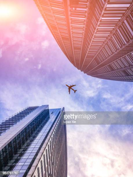 skyscraper with a airplane silhouette - liyao xie stock pictures, royalty-free photos & images