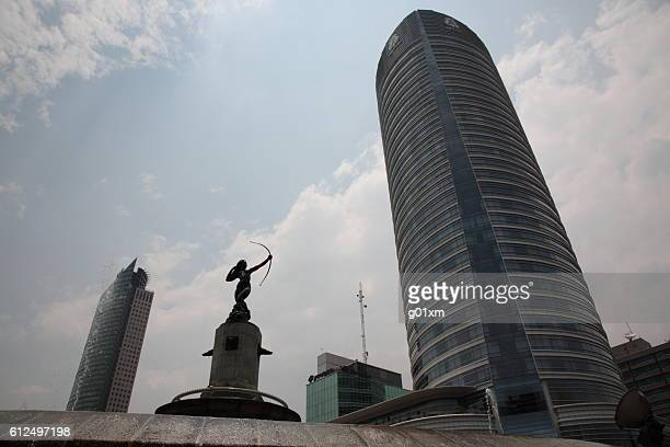 skyscraper with la diana fountain in mexico city, - chapultepec park stock photos and pictures