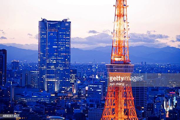 Skyscrapers Aerial view of Tokyo with Tokyo Tower and Roppongi Hills illuminated at night.