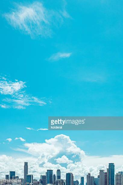 skyscrapers against blue sky - 商業不動産 ストックフォトと画像