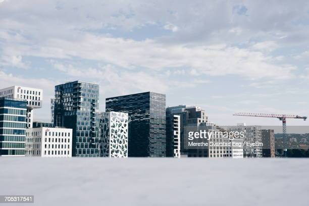 skyscrapers against cloudy sky - oslo stock pictures, royalty-free photos & images