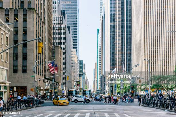 skyscrapers along 6th avenue in new york city, usa - midtown manhattan stock pictures, royalty-free photos & images