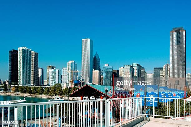 skyscrapers along a lake, lake michigan, navy pier, chicago, illinois, usa - navy pier stock pictures, royalty-free photos & images