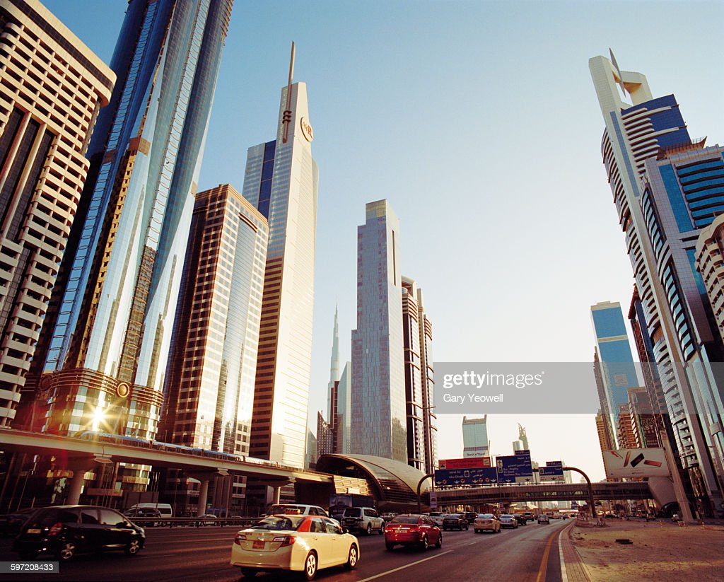 Skyscrapers along Sheikh Zayed Road at sunset : Stock Photo