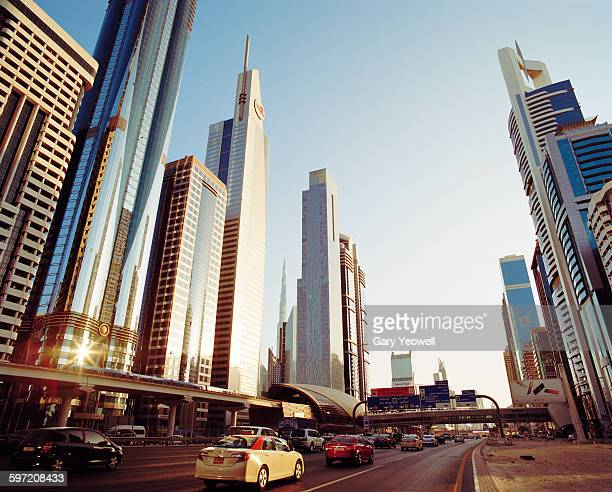 skyscrapers along sheikh zayed road at sunset - ドバイ ストックフォトと画像