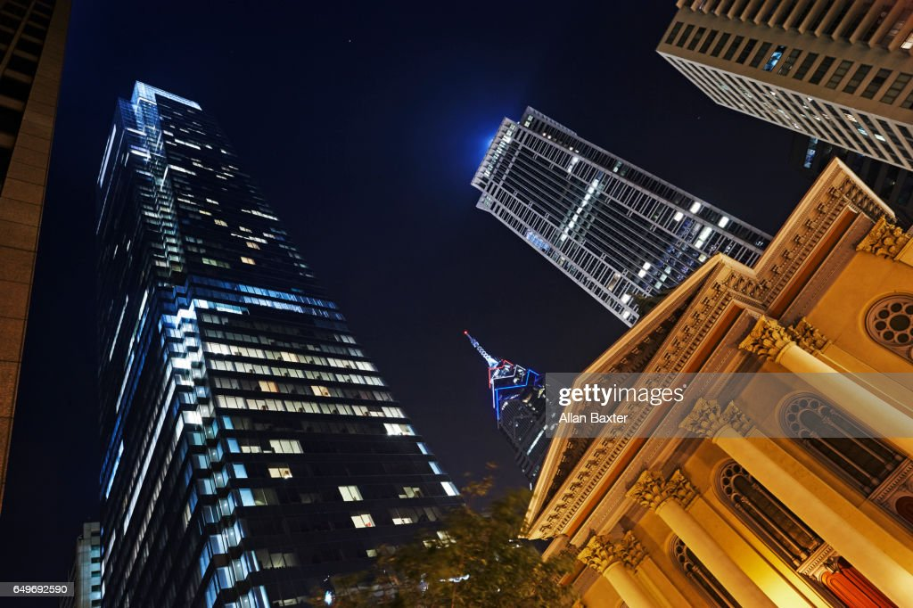 Skyscrapers along Walnut Street illuminated at night : Stock Photo