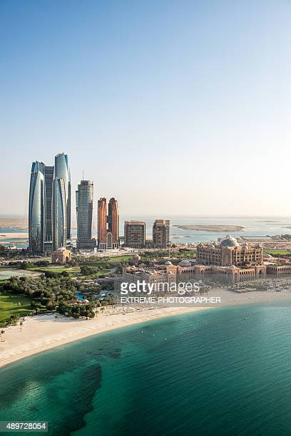 skyscrapers and coastline in abu dhabi - abu dhabi stock pictures, royalty-free photos & images