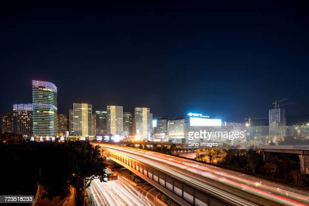 Skyscrapers and highway in Fuzhou city at night, Fujian, China