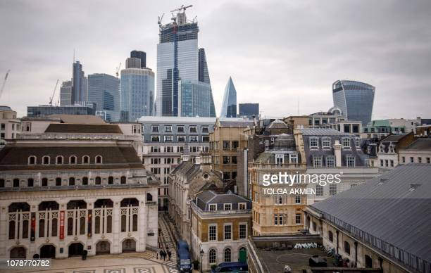 Skyscrapers and modern office buildings are pictured on the horizon beyond older buildings in the City of London from the Guildhall on January 7 2019...