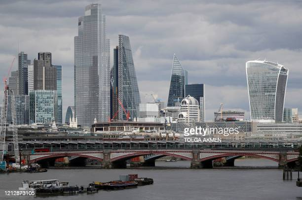 Skyscrapers and office buildings in the City of London, are pictured from across the River Thames on May 13 as people start to return to work after...