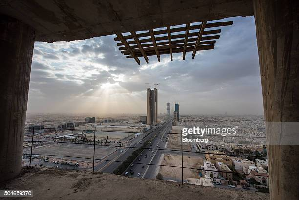 Skyscrapers and residential property sits on the city skyline seen through the window of a skyscraper under construction in Riyadh Saudi Arabia on...
