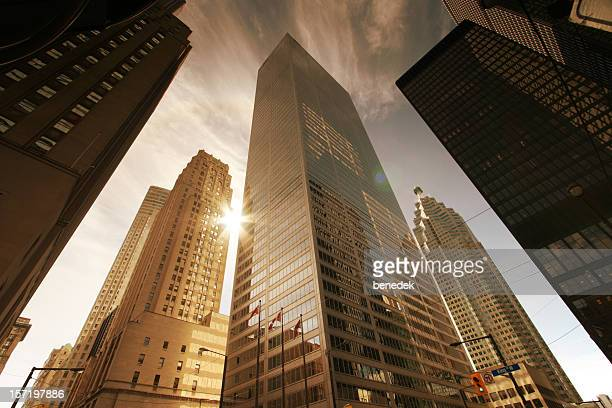 skyscrapers and sun - financial district stock pictures, royalty-free photos & images