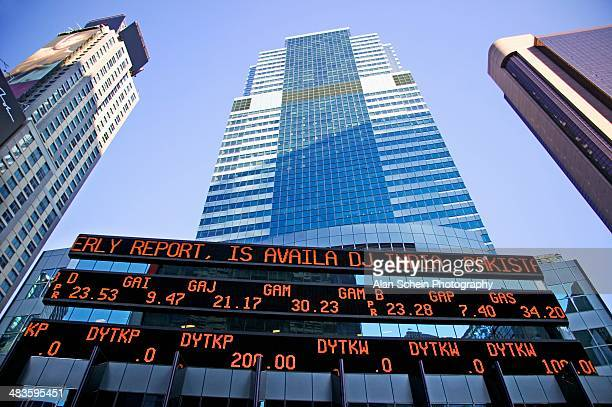 skyscrapers and trading board - trading board stock pictures, royalty-free photos & images