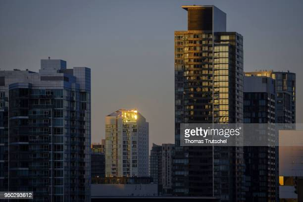 Skyscrapers are illuminated by the rising sun on April 22 2018 in Toronto Canada
