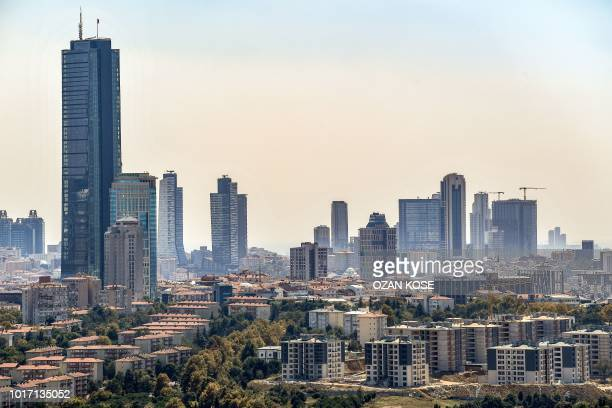 Skyscrapers are pictured at the financial and business district Maslak on August 15 2018 in Istanbul Stock markets fell on August 15 with...