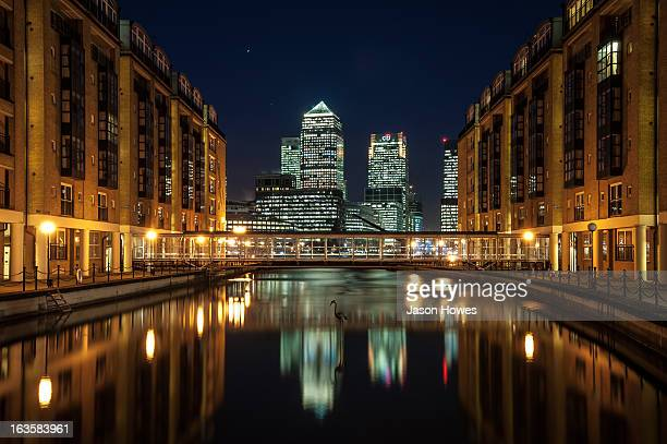 Skyscrapers at Canary Wharf London UK, reflected at night, with a clear blue sky