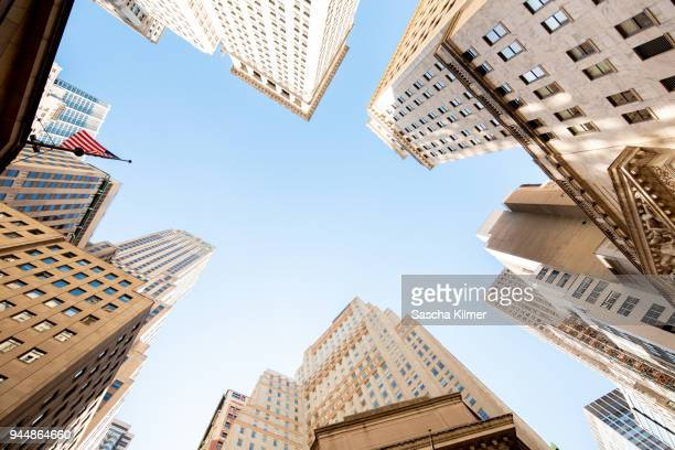 skyscrapers at new york stock exchange, view from below - new york stock exchange stock pictures, royalty-free photos & images