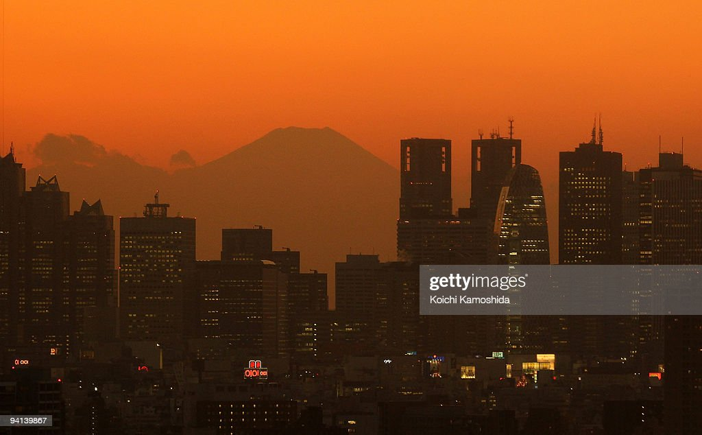 Skyscrapers at Shinjuku business district are seen with a silhouette of Mt. Fuji after sunset on December 8, 2009 in Tokyo, Japan. The United Nations Climate Change Conference in Copenhagen, Denmark will take place between December 6-18 with representatives from over 160 countries discussing the objective to prevent global warming and climate changes.
