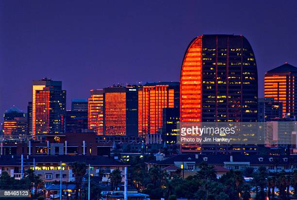skyscrapers at sunset  - phoenix arizona stock photos and pictures
