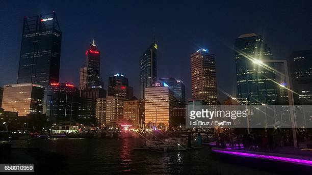 Skyscrapers At Waterfront Lit Up At Night At Elizabeth Quay