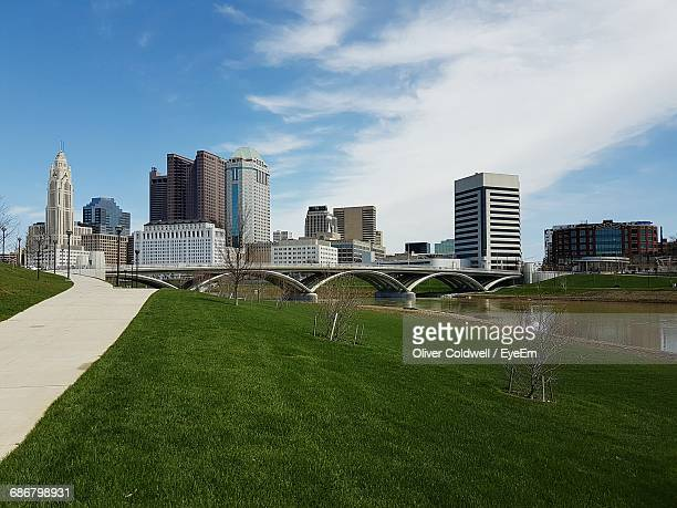 skyscrapers by river against sky - columbus ohio stock photos and pictures