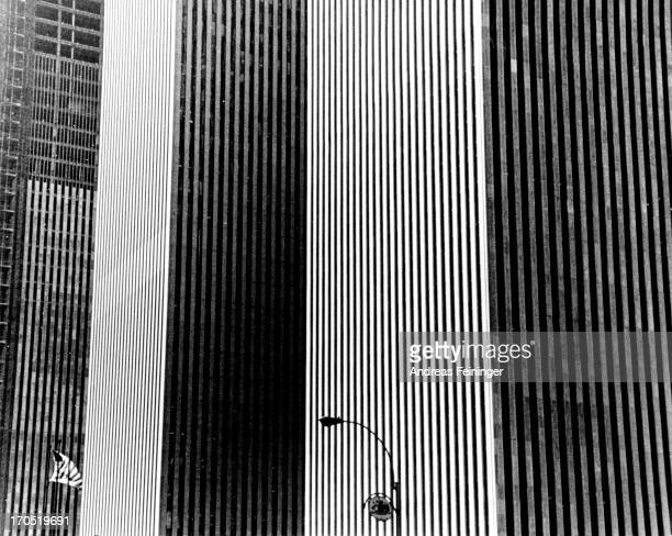 Skyscrapers casts their shadows over each other in a New York City street circa 1980