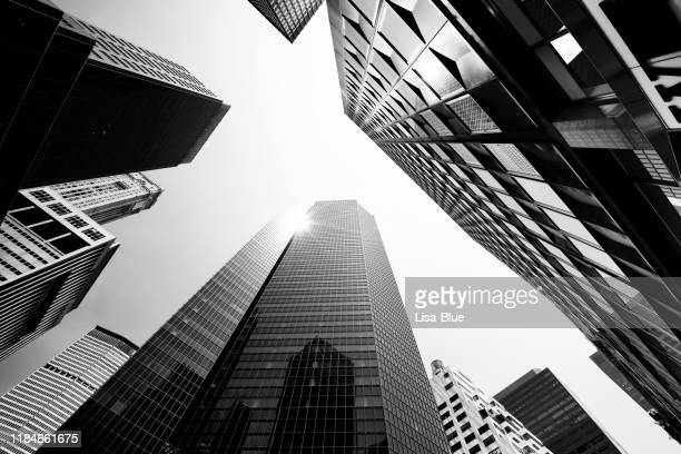 skyscrapers from below, lower manhattan. - skyscraper stock pictures, royalty-free photos & images