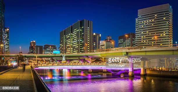 Skyscrapers highways neon night cityscape panorama illuminated dusk Osaka Japan