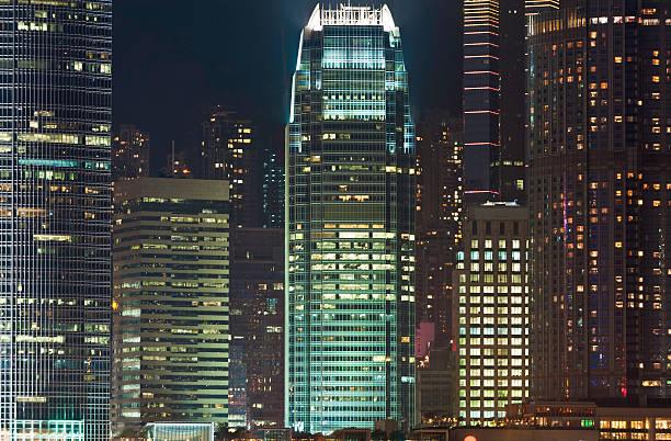 Skyscrapers illuminated crowded cityscape neon night downtown Hong Kong China