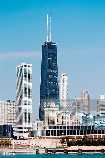 skyscrapers in a city by the lake, chicago, illinois, usa - hancock building chicago stock photos and pictures