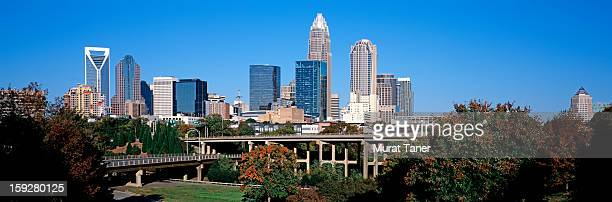 skyscrapers in a city - charlotte north carolina stock pictures, royalty-free photos & images