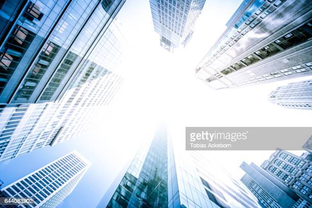 skyscrapers in bright light - toned image stock pictures, royalty-free photos & images