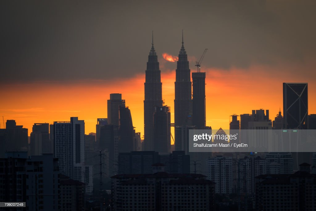 Skyscrapers In City During Sunset : Stock Photo
