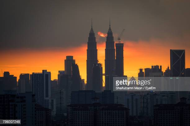 skyscrapers in city during sunset - shaifulzamri stock pictures, royalty-free photos & images