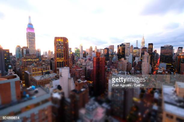 skyscrapers in city during sunset - evan agostini stock pictures, royalty-free photos & images
