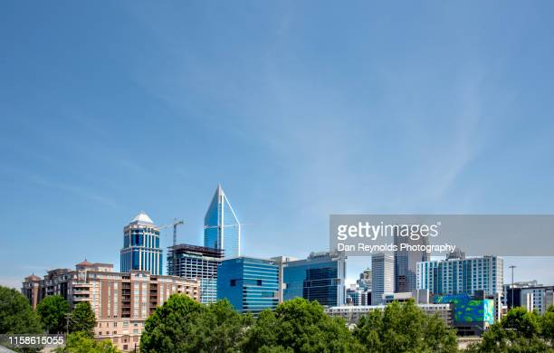 skyscrapers in downtown charlotte - charlotte north carolina stock photos and pictures