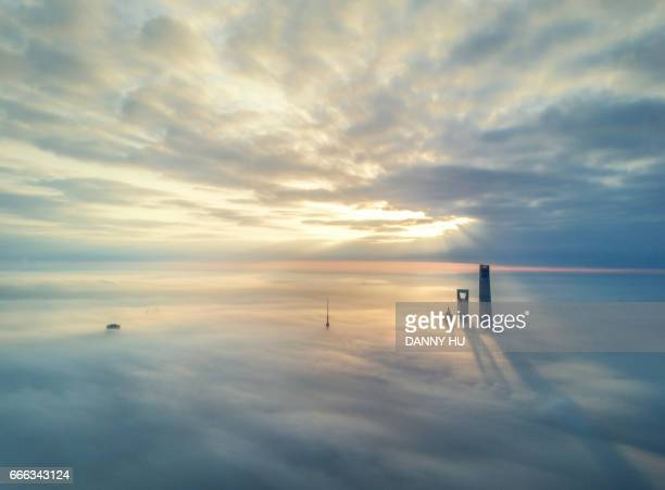 skyscrapers in fog - high up stock photos and pictures