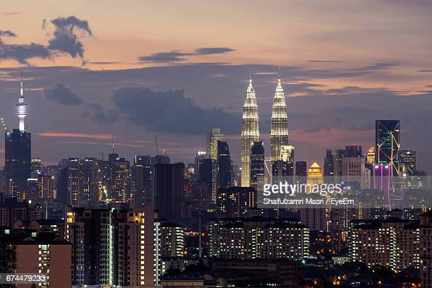 skyscrapers in kuala lumpur at dusk - shaifulzamri stock pictures, royalty-free photos & images