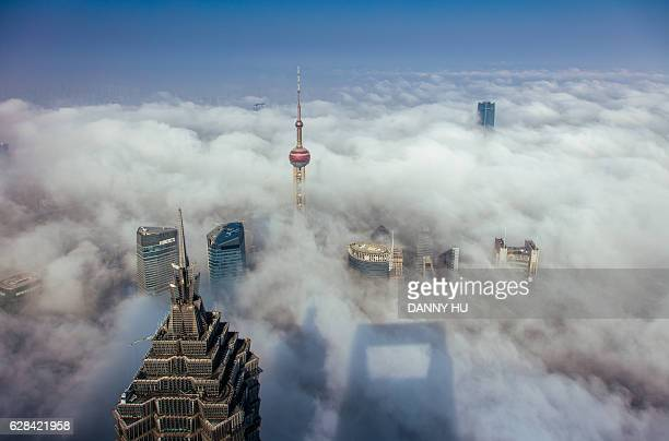 Skyscrapers in lujiazui above the advection fog,Shanghai